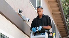 Man working on outside of house