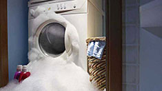 Washing machine flowing over with suds