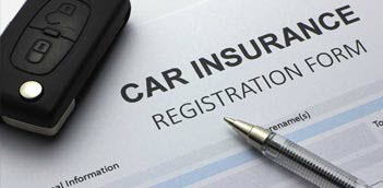 Photo of a car insurance form with car keys and a pen