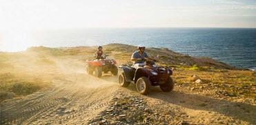 Family riding ATVs in the desert
