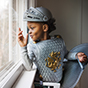 Boy dressed like knight looking out window