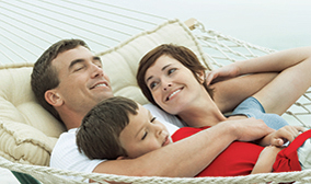 Family laying on a hammock