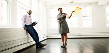 Realtor and tenant looking at an apartment.