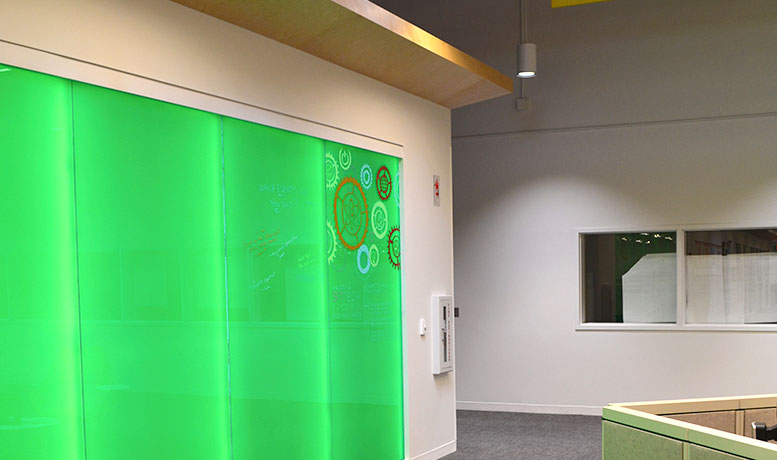 Lighted Walls And Fluorescent Markers Support Collaboration Among IT Employees At Our Insurance Center ISC West In Phoenix