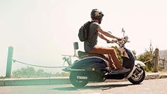 Man driving moped