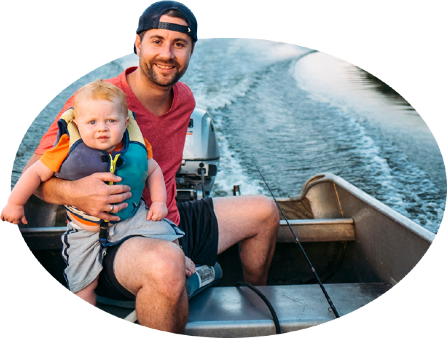 A bearded young father and his life-jacket-wearing toddler motor across the water in a fishing boat, one of the many types covered by State Farm boat insurance.