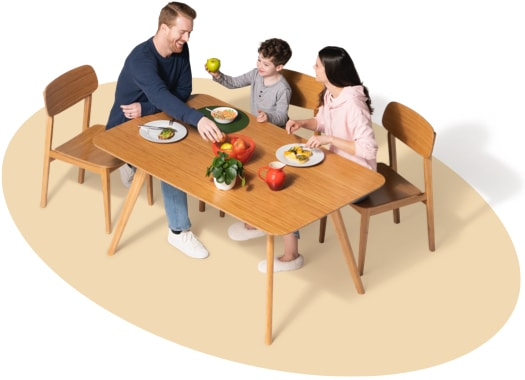 Family of three enjoys a meal at the dining room table.