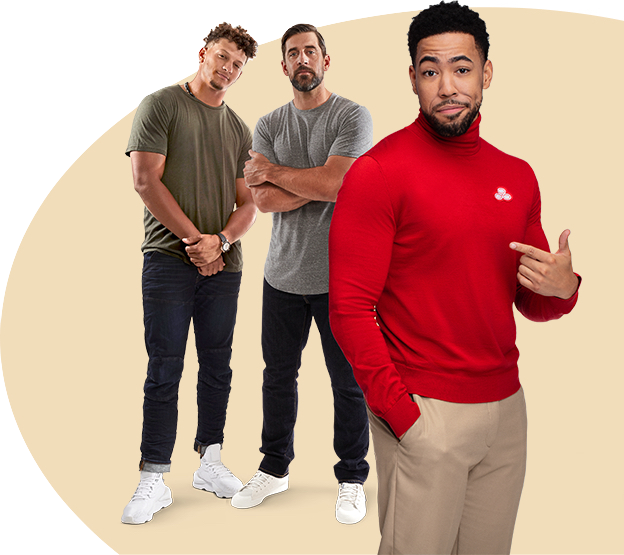 In grey t-shirts and jeans, Patrick Mahomes and Aaron Rodgers pose behind Jake from State Farm.