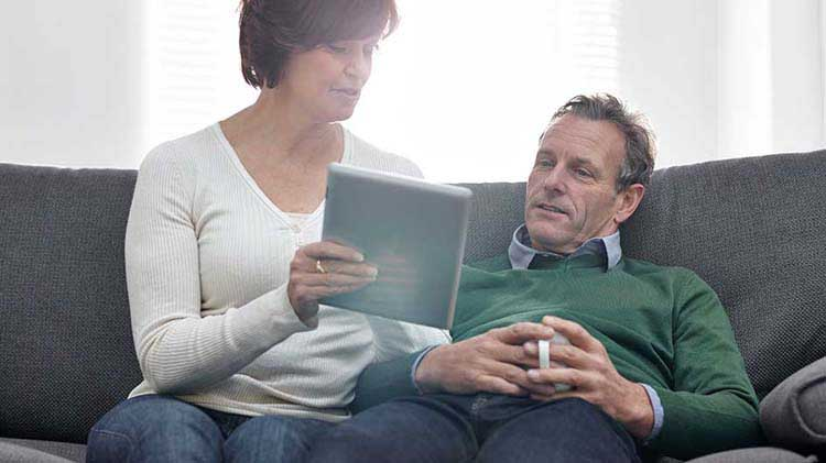 Couple looking at an investment portfolio