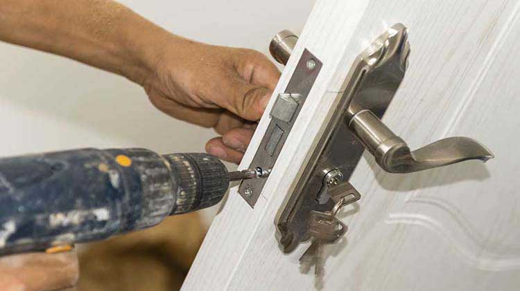 Person installing a door lock