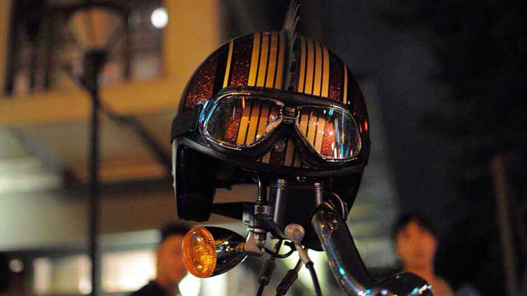 Helmet resting on motorcycle handlebars