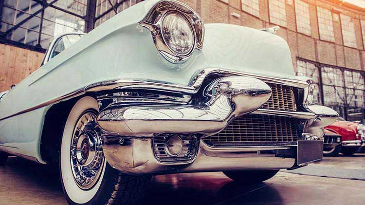 Vintage automobile on a classic car dealership lot