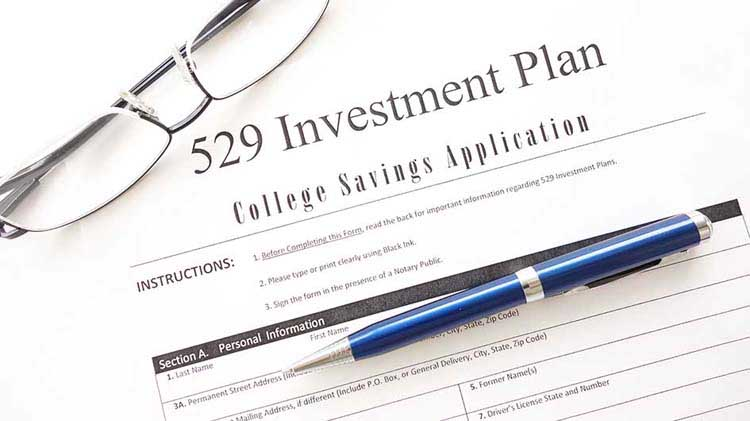 529 Plan form with eyeglasses and pen.