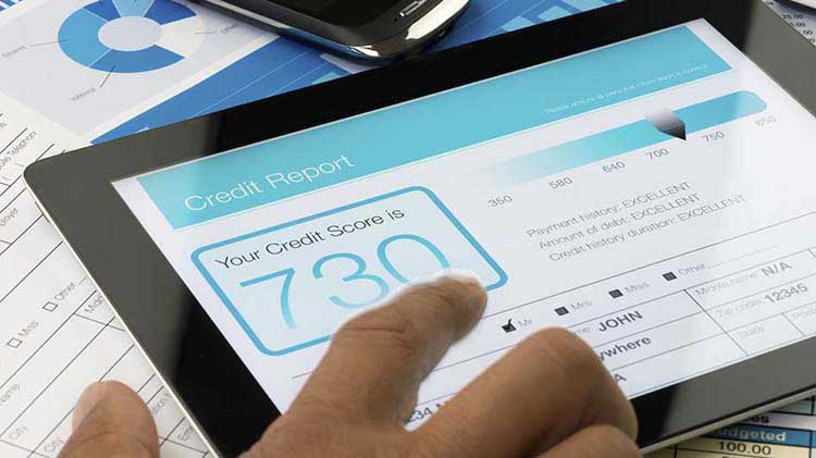A credit report and credit score are shown on a tablet
