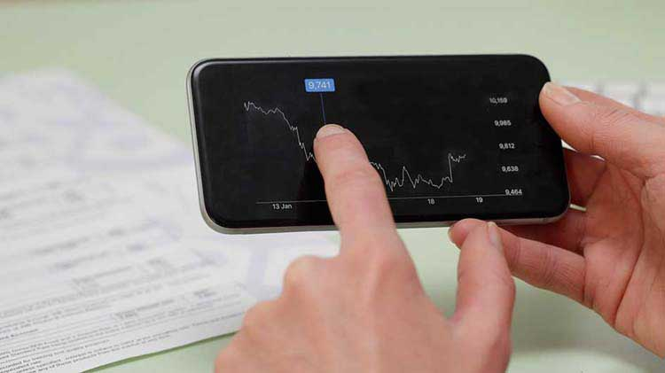 Hands pointing to bond performance on a smartphone