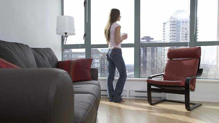 Woman standing at condo window