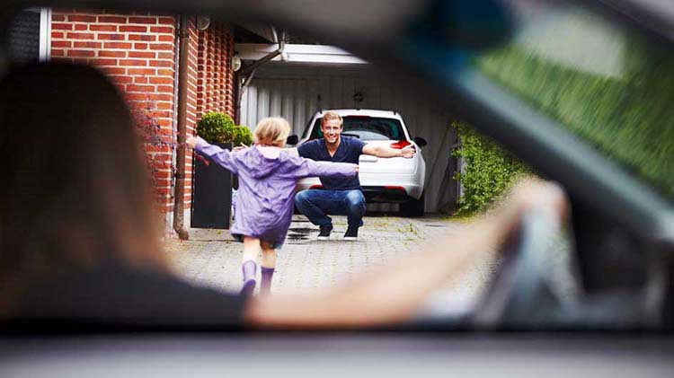 Newly divorced father greets his daughter after her mother drops her off
