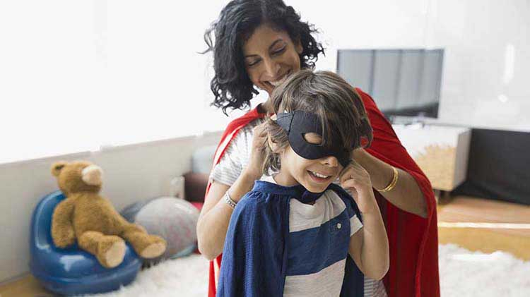 Mom helping her son put on a mask