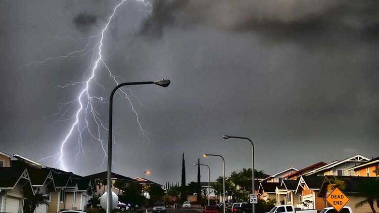 Lightning striking in a residential neighborhood