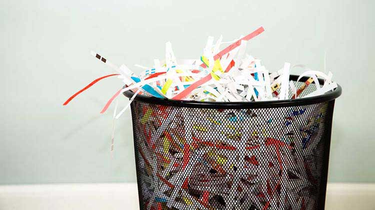 Wastebasket filled with shredded paper