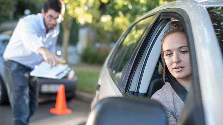 Teen receiving driving instruction