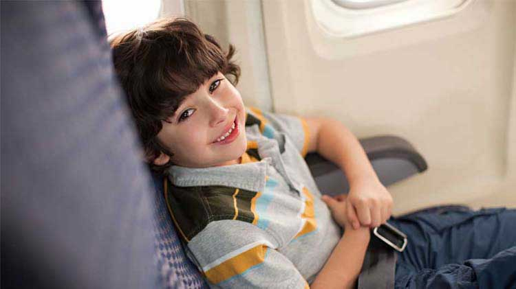 Young boy sitting in an airplane seat