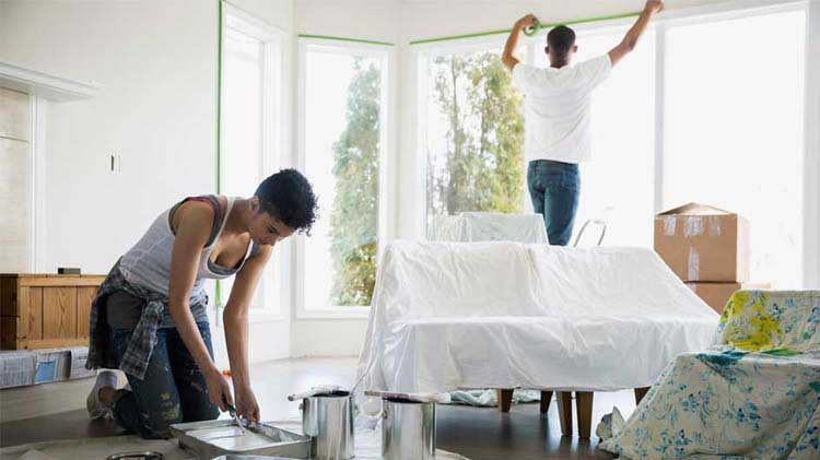 Couple painting their living room