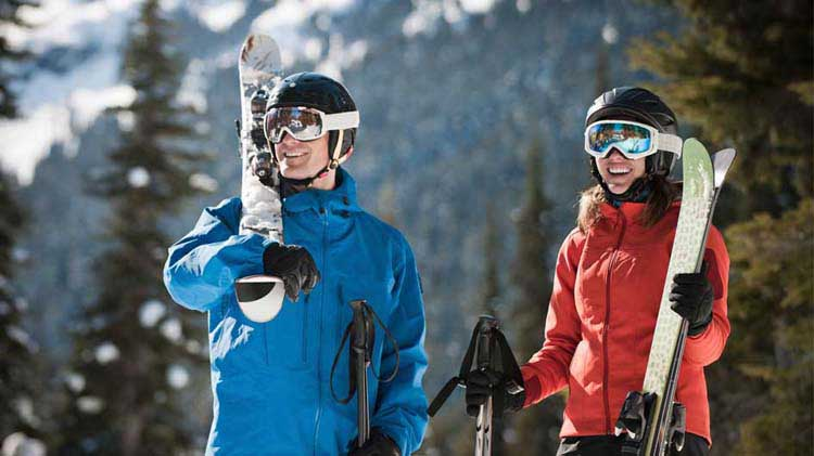 Couple dressed and equipped for skiing
