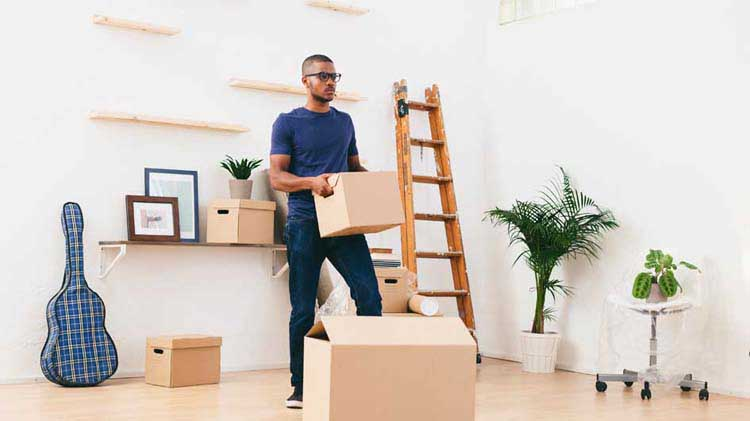 Man packing up his apartment