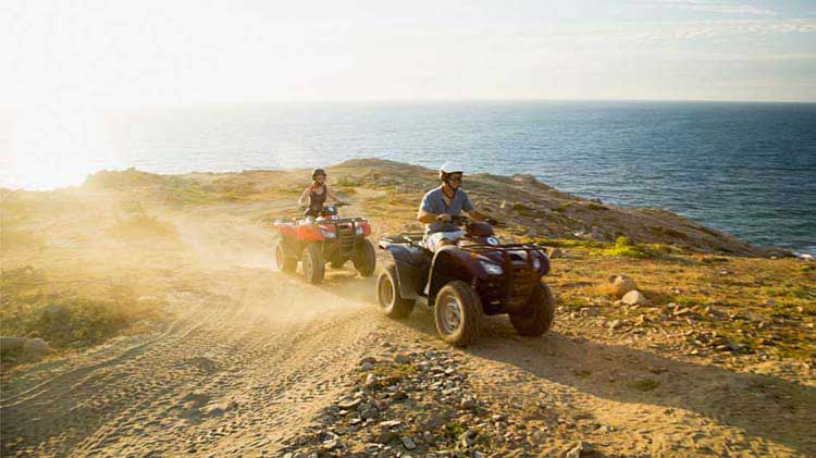 People riding on ATVs