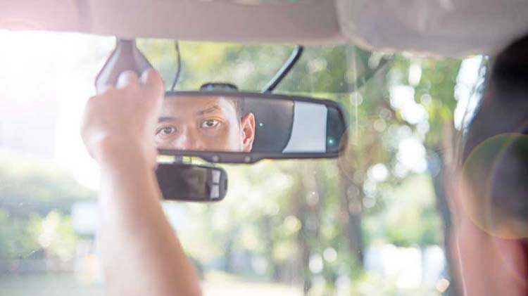Driver looking in rearview mirror