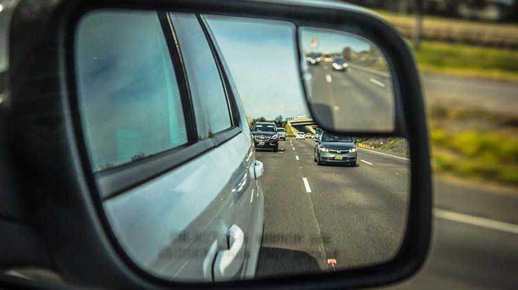 Side mirror view of cars behind you as you are merging.