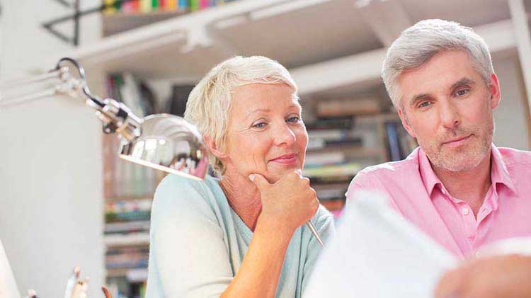 Older couple looks over financial documents