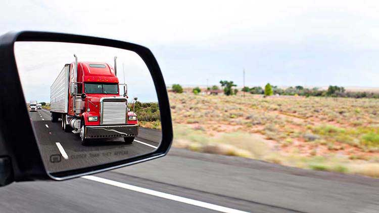 Truck in side mirror