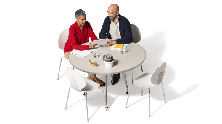 Female agent reviewing annuity options with a customer at a table