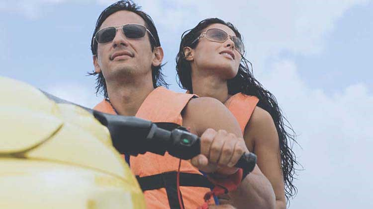 Couple riding a jet ski