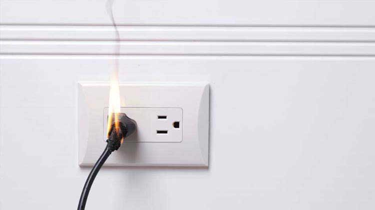 Electrical plug on fire.