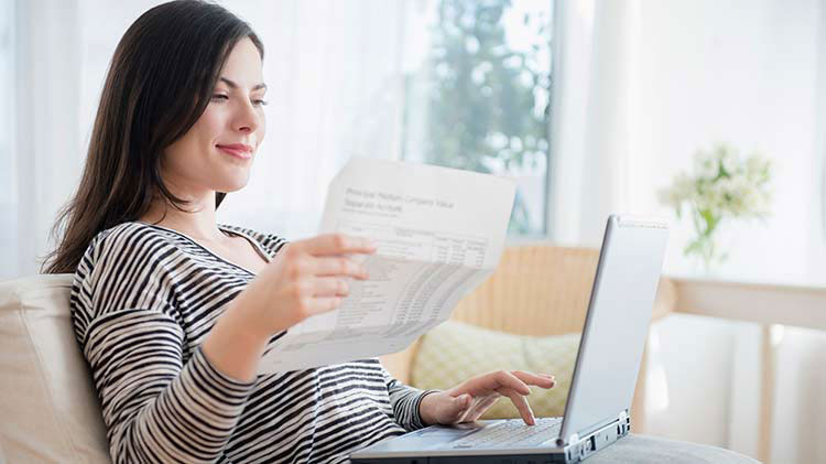Woman creating a budget and managing expenses.