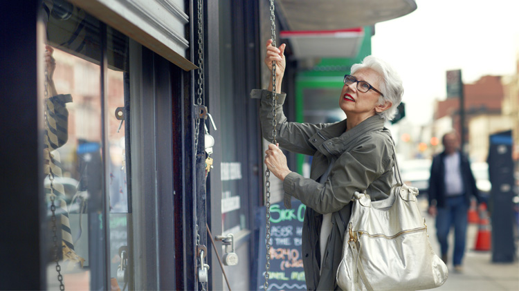 Woman opening store shutter