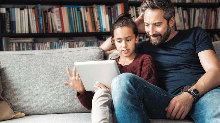 Father and teenager reviewing retirement information
