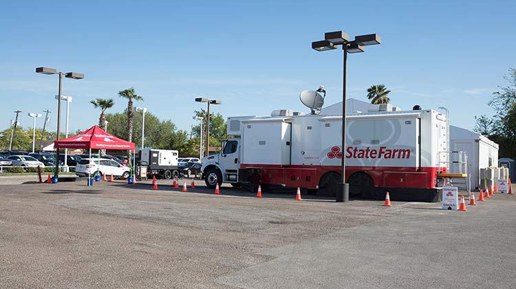 State Farm catastrophe vehicle in a parking lot.