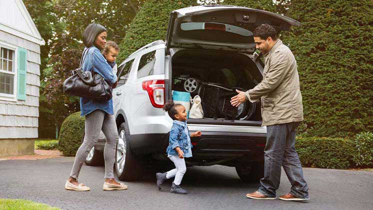 Family unloading things out of a van
