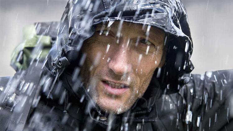 Man in rain gear during a storm.