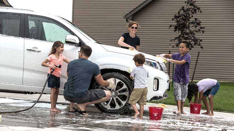 Family washing their car together