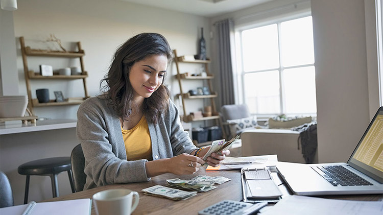 Woman is checking her finances on the computer