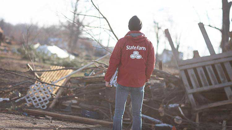 A person looking over the damage caused by a tornado.