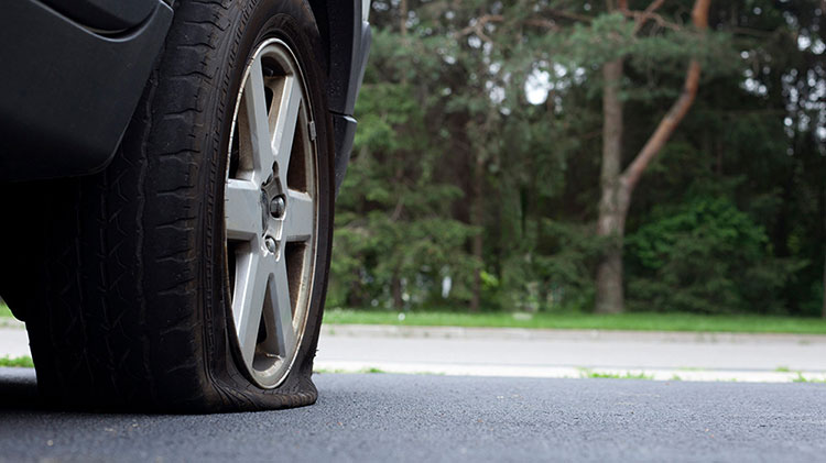 Flat tire created after a driving hazard.