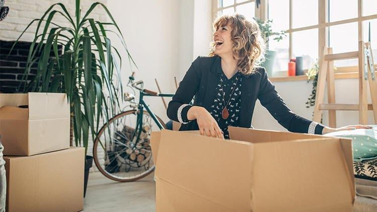 Woman unpacking in a new home