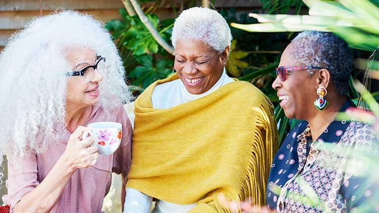 Three women discussing women and retirement
