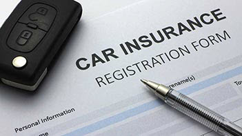 Photo of car insurance form with car keys and a pen